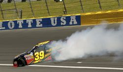 Ryan Sieg (39) spins out of control after driving through turn two during the NASCAR Nationwide series History 300 auto race at Charlotte Motor Speedway in Concord, N.C., Saturday, May 24, 2014. (AP Photo/Chris Keane)
