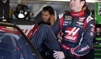 Kurt Busch climbs into his car before practice for Sunday's NASCAR Sprint Cup series Coca-Cola 600 auto race at Charlotte Motor Speedway in Concord, N.C., Saturday, May 24, 2014. (AP Photo/Chris Keane)