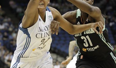 Minnesota Lynx forward Damiris Dantas (34) and New York Liberty center Tina Charles (31) reach for the ball in the first half of a WNBA basketball game, Saturday, May 24, 2014, in Minneapolis. (AP Photo/Stacy Bengs)