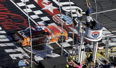 Kyle Larson (42) takes the checkered flag to win the NASCAR Nationwide series History 300 auto race at the Charlotte Motor Speedway in Concord, N.C., Saturday, May 24, 2014. (AP Photo/Gerry Broome)