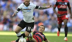 Derby County's Johnny Russell, left, is fouled by Queens Park Rangers' Gary O'Neil  during the English Championship Play Off Final at Wembley Stadium, London Saturday May 24, 2014. The winner of the match gain promotion to the English Premier League next season. O'Neil was sent off for the tackle. (AP Photo/Mike Egerton/PA) UNITED KINGDOM OUT