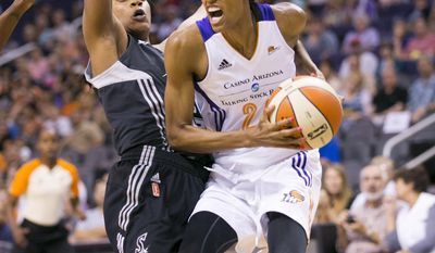 Phoenix Mercury forward DeWanna Bonner drives to the basket as San Antonio Stars guard Jia Perkins defends during the first half of a WNBA basketball game in Phoenix on Friday, May 23, 2014. (AP Photo/The Arizona Republic, David Wallace) MESA OUT  MARICOPA COUNTY OUT  MAGS OUT  NO SALES