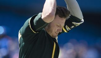 Oakland Athletics' Josh Donaldson throws his helmet after flying out to end the sixth inning of a baseball game against the Toronto Blue Jays in Toronto on Saturday, May 24, 2014.(AP Photo/The Canadian Press, Darren Calabrese)