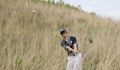 California's Brandon Hagy hits ball from off the fairway on No. 17 during the NCAA Division I men's golf championships at Prairie Dunes Country Club in Hutchinson, Kan., on Saturday, May 24, 2014.  (AP Photo/The Hutchinson News, Calvin Mattheis)