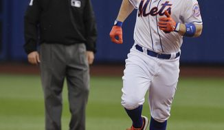New York Mets' David Wright rounds the bases after hitting a solo home run against the Arizona Diamondbacks in the fifth inning of a baseball game, Saturday, May 24, 2014, in New York. (AP Photo/Julie Jacobson)