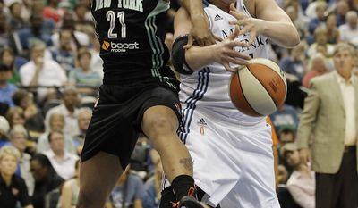 New York Liberty guard Alex Montgomery (21) and Minnesota Lynx center Janel McCarville (4) scramble for possession of a rebound in the first half of a WNBA basketball game, Saturday, May 24, 2014, in Minneapolis. (AP Photo/Stacy Bengs)