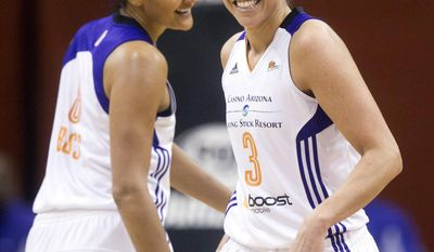 Phoenix Mercury's Diana Taurasi, right, and Mistie Bass celebrate after scoring against the San Antonio Stars during the first half of a WNBA basketball game in Phoenix on Friday, May 23, 2014. (AP Photo/The Arizona Republic, David Wallace)