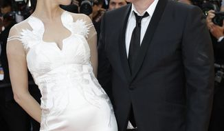 Actress Uma Thurman, left, and director Quentin Tarantino arrive for the awards ceremony at the 67th international film festival, Cannes, southern France, Saturday, May 24, 2014. (AP Photo/Thibault Camus)