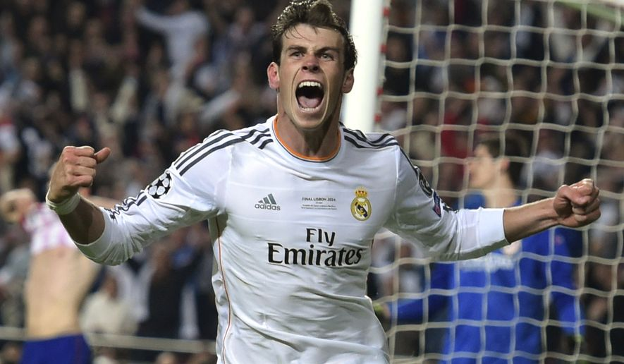 Real's Gareth Bale celebrates scoring his side's 2nd goal, during the Champions League final soccer match between Atletico Madrid and Real Madrid, at the Luz stadium, in Lisbon, Portugal, Saturday, May 24, 2014. (AP Photo/Manu Fernandez)
