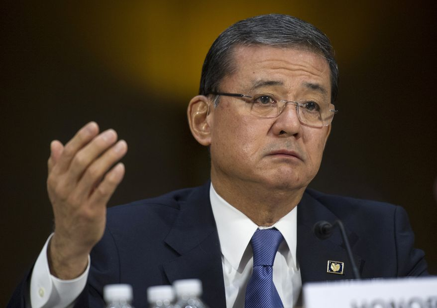 ** FILE ** This May 15, 2014, file photo shows Veterans Affairs Secretary Eric Shinseki testifying on Capitol Hill in Washington. The Department of Veterans Affairs says it will allow more veterans to obtain health care at private hospitals and clinics. Shinseki announced the change Saturday. (AP Photo/Cliff Owen, File)