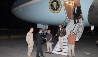 President Barack Obama is greeted by US Ambassador to Afghanistan James Cunningham, second from left, and Marine General Joseph Dunford, commander of the US-led International Security Assistance Force (ISAF), left, as he steps off Air Force One after arriving at Bagram Air Field for an unannounced visit, on Sunday, May 25, 2014, north of Kabul, Afghanistan. (AP Photo/ Evan Vucci)