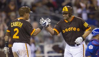 San Diego Padres' Carlos Quentin, right, is congratulated at the plate by Everth Cabrera after hitting a two-run home run in the eighth inning of a baseball game against the Chicago Cubs, Saturday, May 24, 2014, in San Diego. (AP Photo/Sean M. Haffey)