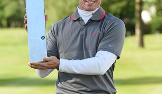 Northern Ireland's Rory Mcilroy with the trophy after he won the BMW PGA Championship at the Wentworth Club, Virginia Water, England, Sunday, May 25, 2014.  (AP Photo/ PA, Adam Davy) UNITED KINGDOM OUT