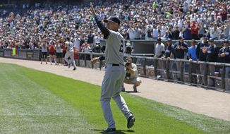 New York Yankees shortstop Derek Jeter waves to the crowd after being presented with gifts from the Chicago White Sox before a baseball game in Chicago on Sunday, May 25, 2014. (AP Photo/Nam Y. Huh)