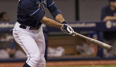 Tampa Bay Rays' pinch hitter Sean Rodriguez hits a three-run homer off Boston Rex reliever Craig Breslow during the seventh inning of a baseball game Sunday, May 25, 2014 in St. Petersburg, Fla. (AP Photo/Steve Nesius)