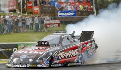 Courtney Force joins her sister Brittany as one of the top qualifiers at the NHRA Kansas Nationals drag races at Heartland Park in Topeka, Kan., Saturday, May 24, 2015. (AP Photo/Topeka Capital-Journal, Chris Neal)