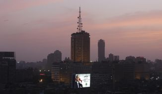 A billboard supporting presidential candidate Abdel-Fattah el-Sissi, the country's former military chief, is seen lighten in front of the television building in Cairo, Egypt, Saturday, May 24, 2014. Considered all but certain to win is el-Sissi, the man who removed the former president, Mohammed Morsi. El-Sissi, who for the past 10 months has been the most powerful figure in Egypt, faces one other candidate in the race, leftist politician Hamdeen Sabahi, who finished third in the 2012 presidential election. (AP Photo/Amr Nabil)