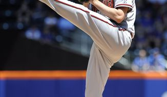 Arizona Diamondbacks starter Bronson Arroyo (61) pitches against the New York Mets in the first inning in game one of a double header baseball game at Citi Field on Sunday, May 25, 2014, in New York. (AP Photo/Kathy Kmonicek)