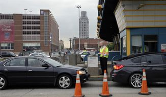 In this May 21, 2014 photo, Delaware River Port Authority CEO John Hanson, hands information cards to drivers in Camden, N.J., at the toll lanes of the Benjamin Franklin Bridge between Camden and Philadelphia. Starting June 3, one of the two sets of PATCO train tracks over the Ben Franklin Bridge will be closed for two months to be replaced. (AP Photo/Mel Evans)
