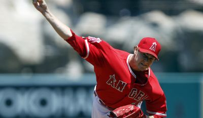 Los Angeles Angels starting pitcher Garrett Richards throws against the Kansas City Royals in the first inning of a baseball game on Sunday, May 25, 2014, in Anaheim, Calif. (AP Photo/Alex Gallardo)