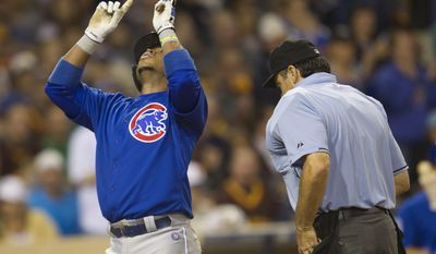 Chicago Cubs' Luis Valbuena reacts to hitting a home run in the sixth inning of a baseball game against the San Diego Padres, Saturday, May 24, 2014, in San Diego. (AP Photo/Sean M. Haffey)