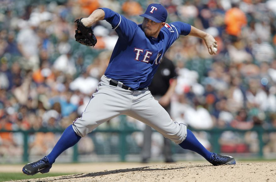 Texas Rangers' Robbie Ross pitches against the Detroit Tigers in the sixth inning of a baseball game against the Detroit Tigers Sunday, May 25, 2014, in Detroit. (AP Photo/Duane Burleson)