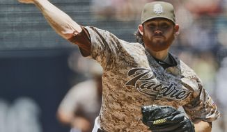 San Diego Padres starting pitcher Ian Kennedy works against the Chicago Cubs during the first inning of a baseball game Sunday, May 25, 2014, in San Diego. (AP Photo/Lenny Ignelzi)