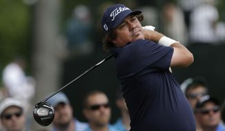 Jason Dufner watches his tee shot on the third hole during the final round of the PGA Colonial golf tournament in Fort Worth, Texas, Sunday, May 25, 2014. (AP Photo/LM Otero)