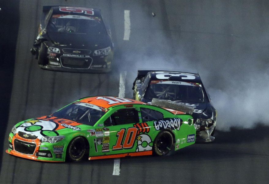 Danica Patrick (10) spins in front of Brian Scott (33) during the NASCAR Sprint Cup series Coca-Cola 600 auto race at the Charlotte Motor Speedway in Concord, N.C., Sunday, May 25, 2014. (AP Photo/Gerry Broome)