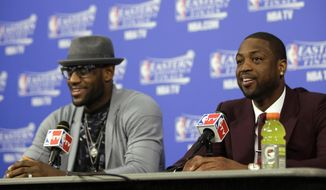 Miami Heat guard Dwyane Wade, right, and forward LeBron James speak during a news conference following Game 3 in the NBA basketball Eastern Conference finals playoff series against the Indiana Pacesr, Saturday, May 24, 2014, in Miami. The Heat defeated the Pacers 99-87. (AP Photo/Lynne Sladky)