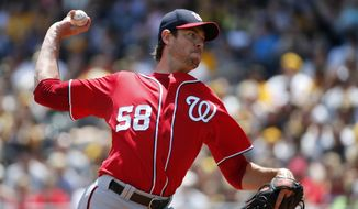 Washington Nationals starting pitcher Doug Fister (58) delivers during the first inning of a baseball game against the Pittsburgh Pirates in Pittsburgh Sunday, May 25, 2014. (AP Photo/Gene J. Puskar)
