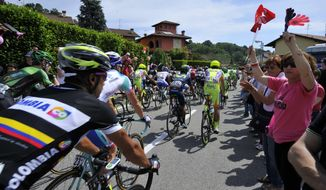 People cheer at cyclists at the start of the 15th stage of the Giro D'Italia cycling race from Valdengo to Plan di Montecampione, Italy, Sunday, May 25, 2014. (AP Photo/Gian Mattia D'Alberto)