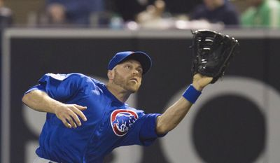 Chicago Cubs right fielder Nate Schierholtz catches a fly ball hit by San Diego Padres' Jedd Gyorko in the seventh inning of a baseball game Saturday, May 24, 2014, in San Diego. (AP Photo/Sean M. Haffey)