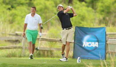 South Carolina's Caleb Sturgis tees off on hole seven in front of Oregon's Brandon McIver during the second round of the NCAA men's golf championship Sunday, May 25, 2014 at Prairie Dunes Country Club in Hutchinson, Kan. (AP Photo/The Hutchinson News, Travis Morisse)