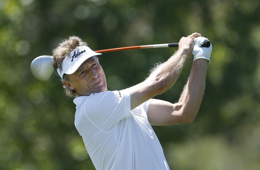 Bernhard Langer hits a tee shot on the fifth hole during the final round of the 75th Senior PGA Championship golf tournament at Harbor Shores Golf Club in Benton Harbor, Mich., Sunday, May 25, 2014. (AP Photo/Paul Sancya)