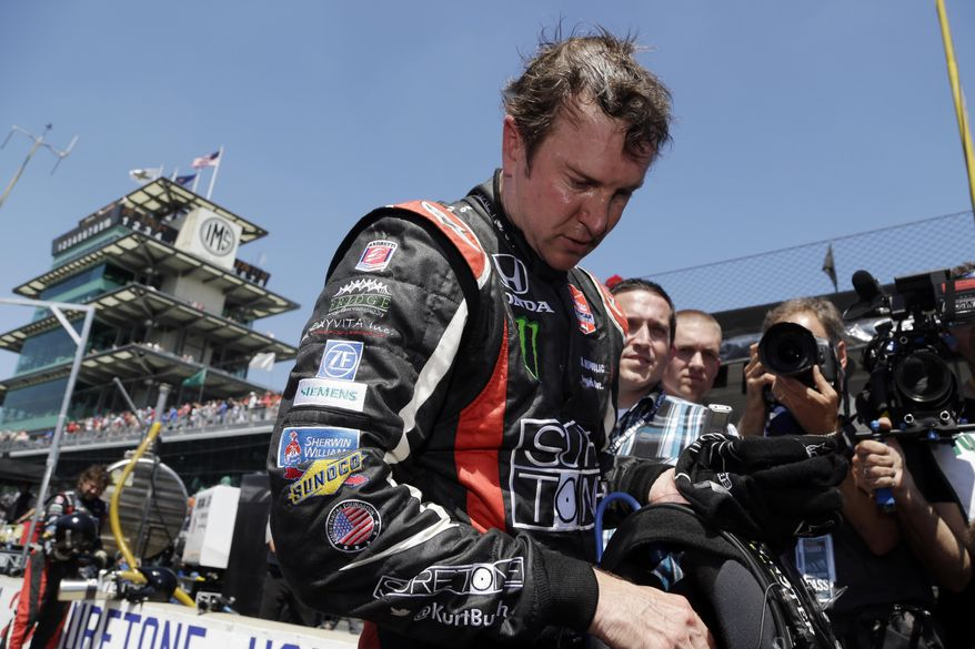 Kurt Busch takes off his helmet after finishing sixth in the 98th running of the Indianapolis 500 IndyCar auto race at the Indianapolis Motor Speedway in Indianapolis, Sunday, May 25, 2014. (AP Photo/R Brent Smith)