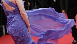 FILE - In this Monday, May 19, 2014 file photo, actress Jessica Chastain poses for photographers as she arrives for the screening of Foxcatcher at the 67th international film festival, Cannes, southern France. (AP Photo/Alastair Grant, File)