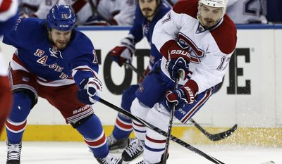 New York Rangers right wing Derek Dorsett (15) defends Montreal Canadiens left wing Rene Bourque (17) during the third period of Game 4 of the NHL hockey Stanley Cup playoffs Eastern Conference finals, Sunday, May 25, 2014, in New York. (AP Photo/Kathy Willens)