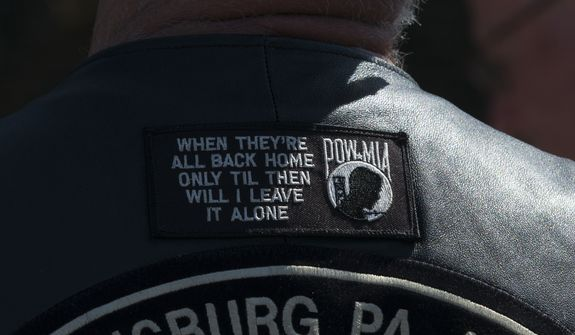 A POW-MIA patch is photographed on the back of a veterans jacket while visiting the Vietnam Veterans Memorial in Washington, Sunday, May 25, 2014. (AP Photo/Molly Riley)