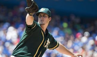 Oakland Athletics starting pitcher Drew Pomeranz works against the Toronto Blue Jays during first inning of a baseball game in Toronto on Sunday, May 25, 2014. (AP Photo/The Canadian Press, Nathan Denette)