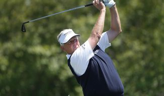Colin Montgomerie hits a tee shot on the fourth hole during the final round of the 75th Senior PGA Championship golf tournament at Harbor Shores Golf Club in Benton Harbor, Mich., Sunday, May 25, 2014. (AP Photo/Paul Sancya)
