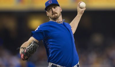 Chicago Cubs starter Travis Wood pitches in the first inning of a baseball game against the San Diego Padres, Saturday, May 24, 2014, in San Diego. (AP Photo/Fre/Sean M. Haffey)