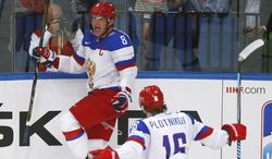 Russia forward Alexander Ovechkin (8) celebrates a goal with Sergei Plotnikov (16) during the gold medal match against Finland at the Ice Hockey World Championship in Minsk, Belarus, Sunday, May 25, 2014. Russea won 5-2. (AP Photo/Sergei Grits)
