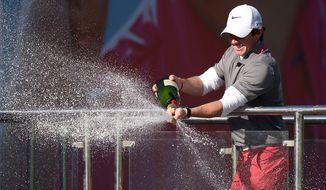 Northern Ireland's Rory Mcilroy celebrates winning the BMW PGA Championship at the Wentworth Club, Virginia Water, England, Sunday, May 25, 2014.  (AP Photo/ PA, Adam Davy) UNITED KINGDOM OUT NO SALES NO ARCHIVE