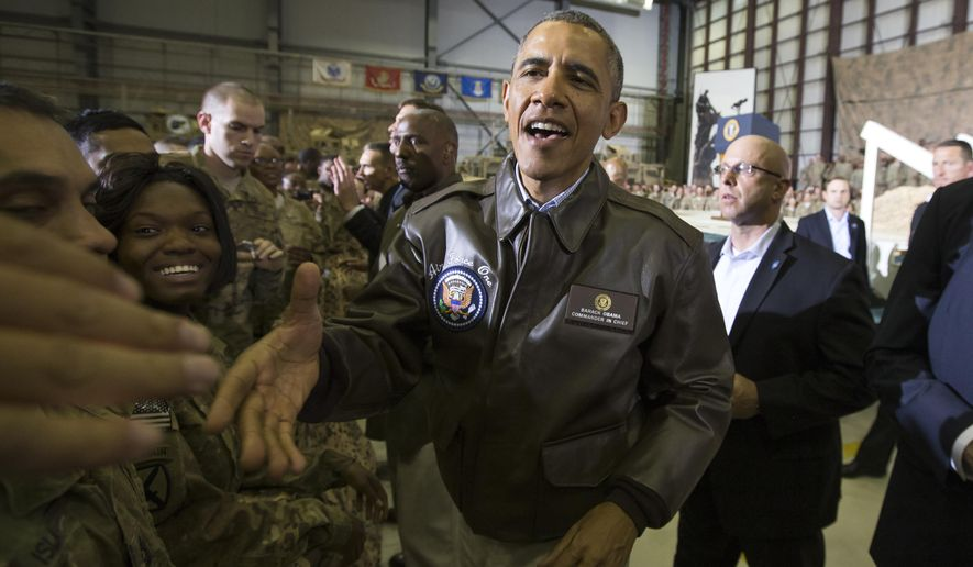 President Barack Obama shakes hands during a troop rally at Bagram Air Field during an unannounced visit, on Sunday, May 25, 2014, north of Kabul, Afghanistan. (AP Photo/ Evan Vucci)