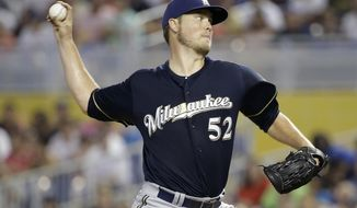 Milwaukee Brewers starting pitcher Jimmy Nelson throws in the first inning during a baseball game against the Miami Marlins, Sunday, May 25, 2014, in Miami. (AP Photo/Lynne Sladky)