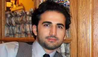 ** FILE ** This undated file photo released by his family via FreeAmir.org shows Amir Hekmati. The former U.S. Marine convicted of criminal charges in Iran after being accused of working for the CIA will appeal for a new trial after already seeing his sentence reduced once, an Iranian news agency reported Sunday, May 25, 2014. (AP Photo/Hekmati family via FreeAmir.org, File)