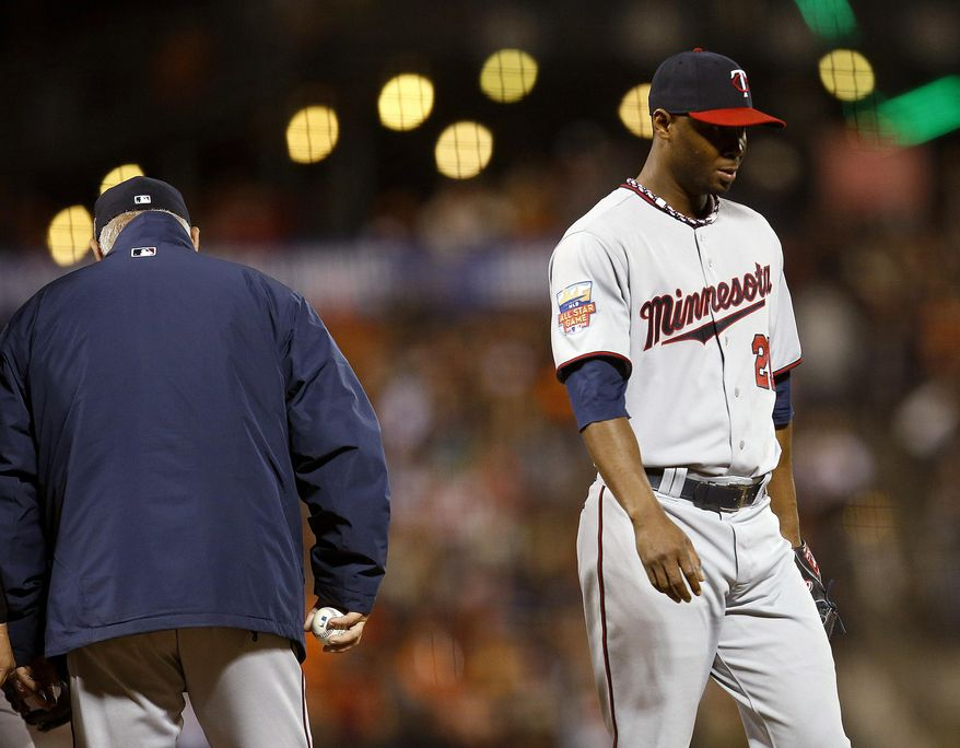 Minnesota Twins pitcher Samuel Deduno is taken out of the baseball game by manager Ron Gardenhire, left, during the sixth inning against the San Francisco Giants on Saturday, May 24, 2014, in San Francisco. (AP Photo/Tony Avelar)