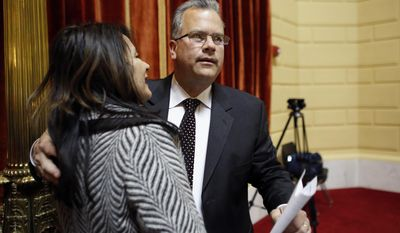 In this April 30, 2014 photo, Rhode Island House Speaker Nicholas Mattiello, right, greets Martha Aktchian, of Cranston, R.I., left, on the floor of the House Chamber at the Statehouse, in Providence, R.I. Mattiello is a centrist Democrat and former majority leader whose meteoric rise to the position followed the downfall of Gordon Fox. (AP Photo/Steven Senne)