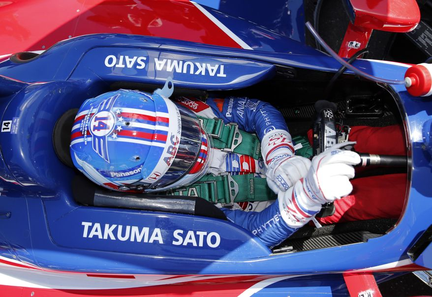 Takuma Sato, of Japan, prepares to drive before the start of the 98th running of the Indianapolis 500 IndyCar auto race at the Indianapolis Motor Speedway in Indianapolis, Sunday, May 25, 2014. (AP Photo/Robert Baker)